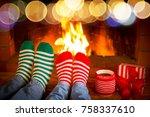 couple in christmas socks near... | Shutterstock . vector #758337610