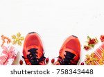 pair of red sport shoes with... | Shutterstock . vector #758343448