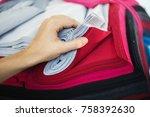 woman choosing fabric colors.   Shutterstock . vector #758392630