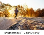 man jogging on cold sunny... | Shutterstock . vector #758404549
