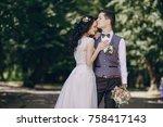 bride and groom walking in a... | Shutterstock . vector #758417143