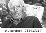 elder man relaxing at home on a ... | Shutterstock . vector #758417194