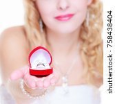 Small photo of Marriage, proposing, future wife concept. Bride wearing white long dress showing proposal ring.