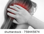 Small photo of Woman with earache is holding her aching ear - black and white body pain concept
