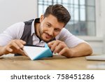 creative businessman examining... | Shutterstock . vector #758451286