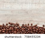 coffee beans on wood background | Shutterstock . vector #758455234