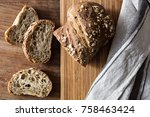 sliced bread on wooden table | Shutterstock . vector #758463424