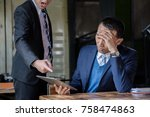 stressed asian business man... | Shutterstock . vector #758474863