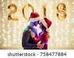 young romantic couple in santa... | Shutterstock . vector #758477884