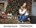 young mother playing with her... | Shutterstock . vector #758506294