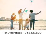 happy familes flying with kite... | Shutterstock . vector #758521870