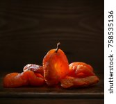 dried apricots on a dark wooden ... | Shutterstock . vector #758535136