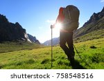 woman with backpack hiking in... | Shutterstock . vector #758548516