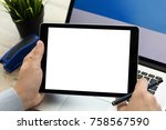 man holding tablet with...   Shutterstock . vector #758567590