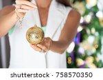 woman hands holding christmas... | Shutterstock . vector #758570350