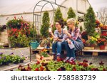 two cute friendly florist girls ... | Shutterstock . vector #758583739