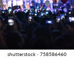 hand with a smartphone records... | Shutterstock . vector #758586460