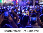 hand with a smartphone records... | Shutterstock . vector #758586490