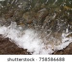 the wave of sea while impacting ... | Shutterstock . vector #758586688