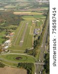 Small photo of 16-10-2017, Etten Leur, Holland. Aerial view of Seppe Breda International Airport. A small airstrip in the province of Noord-Brabant with a restaurant, tower and concrete runway between green fields.