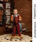 little baby boy on rocking... | Shutterstock . vector #758595724