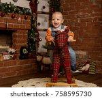 little baby boy on rocking... | Shutterstock . vector #758595730