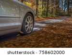 car driving on a street covered ... | Shutterstock . vector #758602000