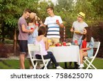 young friends having barbecue... | Shutterstock . vector #758625070