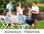 young friends having barbecue... | Shutterstock . vector #758625106