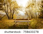 empty park bench in mountain... | Shutterstock . vector #758633278