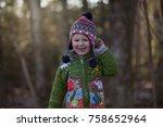 a little boy is in the woods... | Shutterstock . vector #758652964