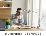 handsome young freelancer... | Shutterstock . vector #758704738