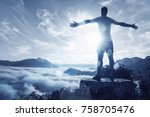 man on a summit over an ocean... | Shutterstock . vector #758705476