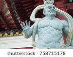 Chinese God statue at  Buddha Tooth Relic Temple and Museum at Chinatown in Singapore