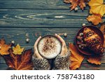 Small photo of Cup of hot cappuchino coffee with chocolate croissant, Autumn mood, holding hands, top view , warm and cozy
