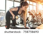 fit young woman lifting weight... | Shutterstock . vector #758758693