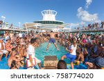 Small photo of NASSAU, BAHAMAS - SEPTEMBER, 08, 2014: People having fun in pool on Royal Caribbean's ship, Majesty of the Seas, sails in the Port of the Bahamas on September 06, 2014