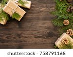Small photo of Christmas background with decorations and gift boxes on dark wooden board with copy space for your text.