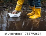 child with yellow rain boots... | Shutterstock . vector #758793634