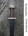 Small photo of The hilt and handle of an early medieval war sword.