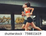 couple of runners jogging on... | Shutterstock . vector #758811619
