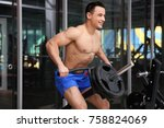 muscular man training in gym | Shutterstock . vector #758824069