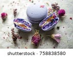 purple macarons with wildflowers | Shutterstock . vector #758838580