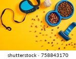 Stock photo dog accessories on yellow background top view pets and animals concept 758843170