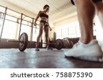 healthy young woman working out ... | Shutterstock . vector #758875390