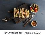 on a wooden board a sandwich of ... | Shutterstock . vector #758884120