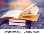 open book with magic lights.... | Shutterstock . vector #758894026