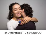 woman thanks with a hug she... | Shutterstock . vector #758920900