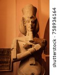 Small photo of A Statue of Pharaoh Akhenaten (Amenhotep IV) - ancient Egyptian in 12 Apr 2015, Egyptian Museum Cairo