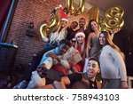 group of cheerful friends makes ... | Shutterstock . vector #758943103